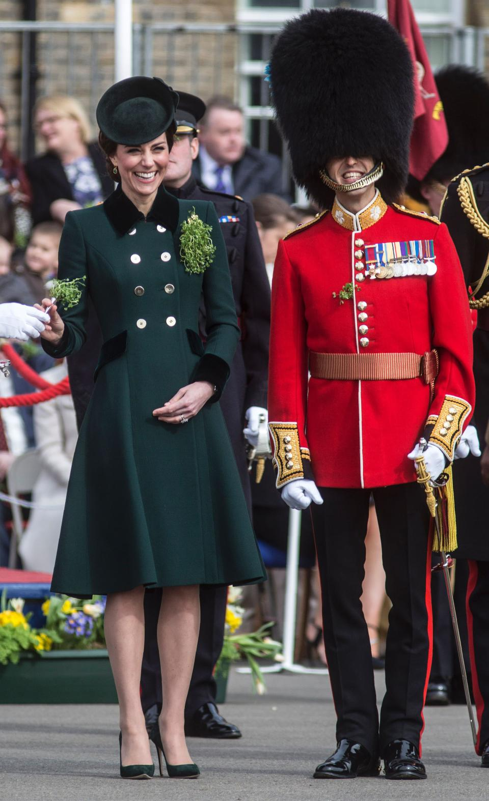 <p>In 2017, the Duchess turned to one of the late Princess Diana's favourite designers for her coat: Catherine Walker. The dark green number, adorned with two rows of gold buttons, was decorated with her Irish Guards brooch and boasted a black trim. <em>[Photo: Getty]</em> </p>