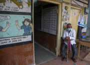 An elderly man waits to get inoculated during a special vaccination drive against COVID-19 in Hyderabad, India, Saturday, July 24, 2021. (AP Photo/Mahesh Kumar A.)