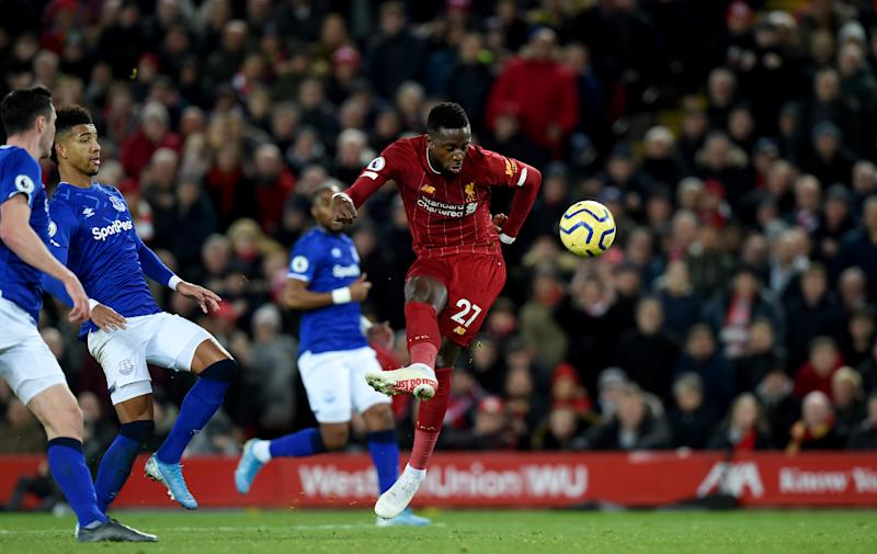 LIVERPOOL, ENGLAND - DECEMBER 04: (THE SUN OUT, THE SUN ON SUNDAY OUT) Divock Origi of Liverpool Scores the second goal during the Premier League match between Liverpool FC and Everton FC at Anfield on December 04, 2019 in Liverpool, United Kingdom. (Photo by John Powell/Liverpool FC via Getty Images)