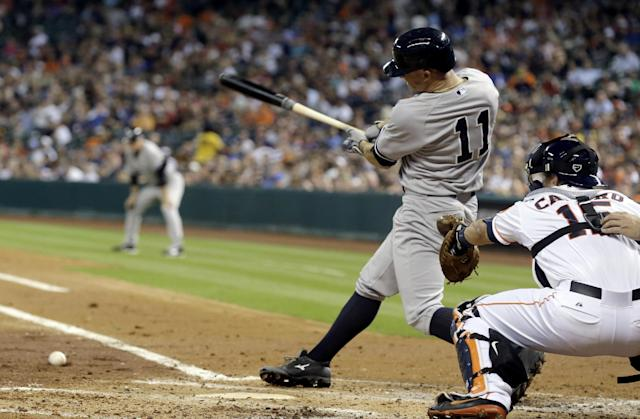 New York Yankees' Brett Gardner (11) hits an RBI-single in front of Houston Astros catcher Jason Castro (15) in the third inning of a baseball game on Thursday, April 3, 2014, in Houston. (AP Photo/Pat Sullivan)