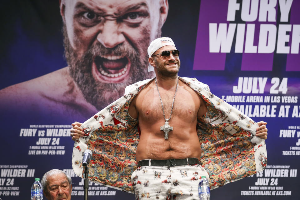 LOS ANGELES, CALIFORNIA - JUNE 15: Tyson Fury interacts with the crowd during the press conference with Deontay Wilder at The Novo by Microsoft at L.A. Live on June 15, 2021 in Los Angeles, California. (Photo by Meg Oliphant/Getty Images)