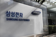 A logo of Samsung Electronics is seen outside of Samsung Electronics Seocho building in Seoul, South Korea, Sunday, Oct. 25, 2020. Billionaire Samsung scion Lee Jae-yong was sent back to prison on Monday after a South Korean court sentenced him to two and a half years over his involvement in a 2016 corruption scandal that spurred massive street protests and ousted South Korea's then-president. (AP Photo/Lee Jin-man)