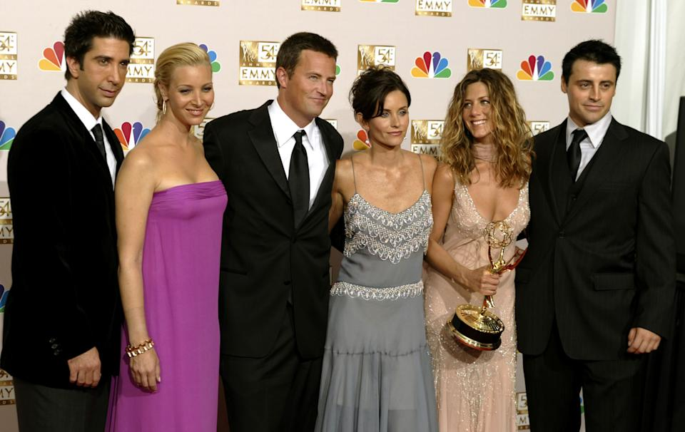 """The cast of """"Friends"""" appears in the photo room at the 54th annual Emmy  Awards in Los Angeles September 22, 2002. From the left are, David  Schwimmer, Lisa Kudrow, Matthew Perry, Courteney Cox Arquette, Jennifer  Aniston and Matt LeBlanc. Aniston won Outstanding Lead Actress in a  comedy series for her role on the show. REUTERS/Mike Blake    RG"""