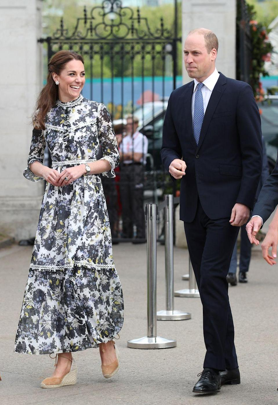 "<p>To show the Queen a garden she'd designed at the Chelsea Flower Show,<a href=""https://www.townandcountrymag.com/style/fashion-trends/a27530823/kate-middleton-erdem-dress-chelsea-flower-show-2019/"" rel=""nofollow noopener"" target=""_blank"" data-ylk=""slk:the Duchess went for a high-necked, floral Erdem dress"" class=""link rapid-noclick-resp""> the Duchess went for a high-necked, floral Erdem dress</a>, along with a pair of summery espadrilles.</p>"