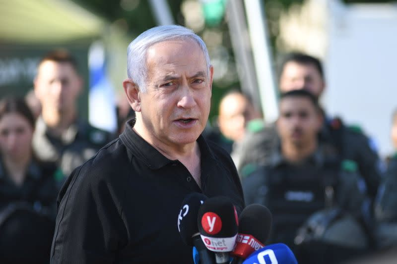 Israeli Prime Minister Benjamin Netanyahu meets with Israeli border police following violence in the Arab-Jewish town of Lod