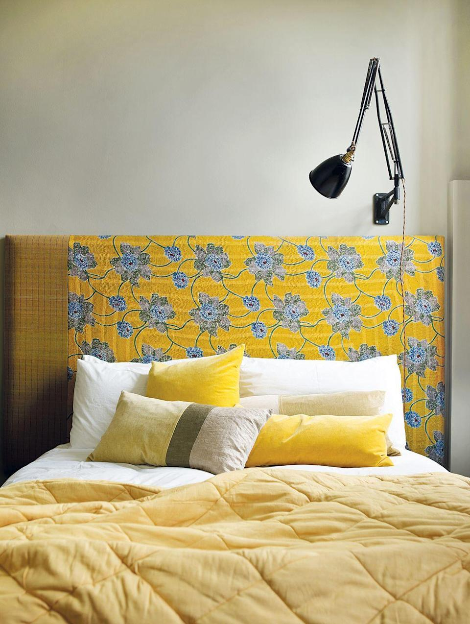 <p>Uplift your design scheme with an eye-catching floral headboard. Choosing a vibrant hue, like yellow, can act as the perfect balance to neutral-colored walls. </p>