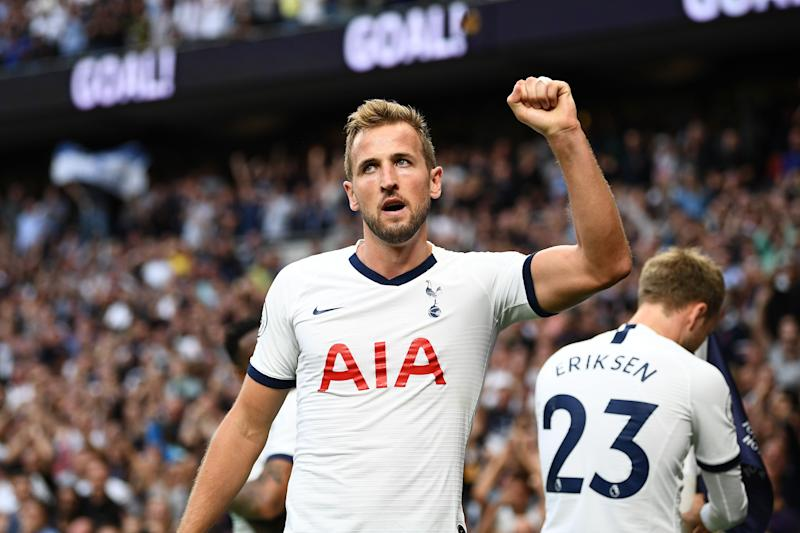 Tottenham Hotspur's English striker Harry Kane celebrates after he scores the team's second goal during the English Premier League football match between Tottenham Hotspur and Aston Villa at Tottenham Hotspur Stadium in London, on August 10, 2019. (Photo by Daniel LEAL-OLIVAS / AFP) / RESTRICTED TO EDITORIAL USE. No use with unauthorized audio, video, data, fixture lists, club/league logos or 'live' services. Online in-match use limited to 120 images. An additional 40 images may be used in extra time. No video emulation. Social media in-match use limited to 120 images. An additional 40 images may be used in extra time. No use in betting publications, games or single club/league/player publications. / (Photo credit should read DANIEL LEAL-OLIVAS/AFP/Getty Images)