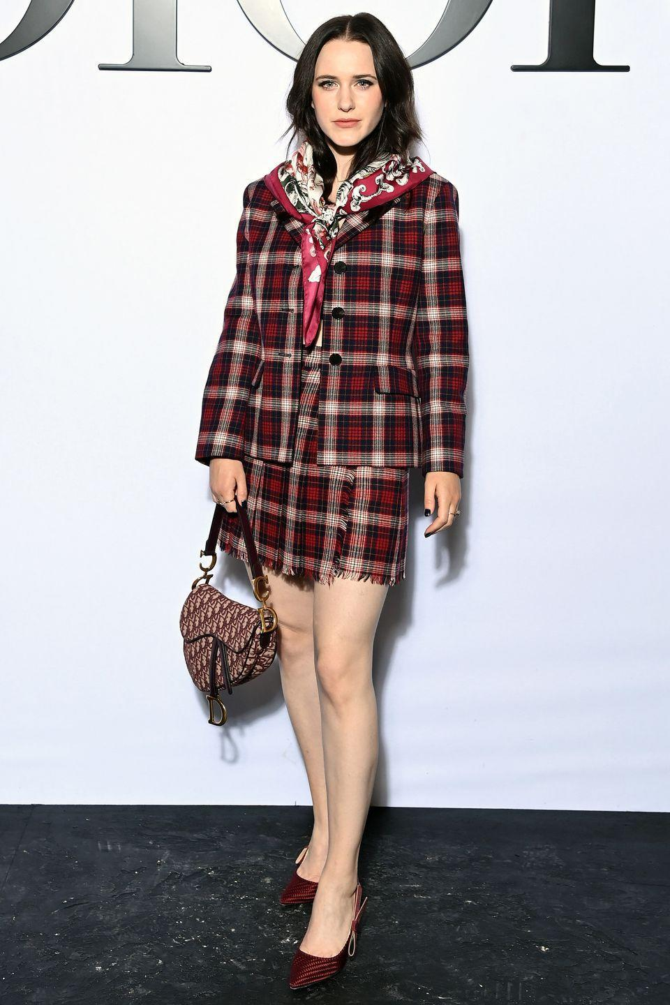 <p><strong>28 September </strong></p><p>Rachel Brosnahan paired her checked skirt suit with a Dior saddle bag.</p>