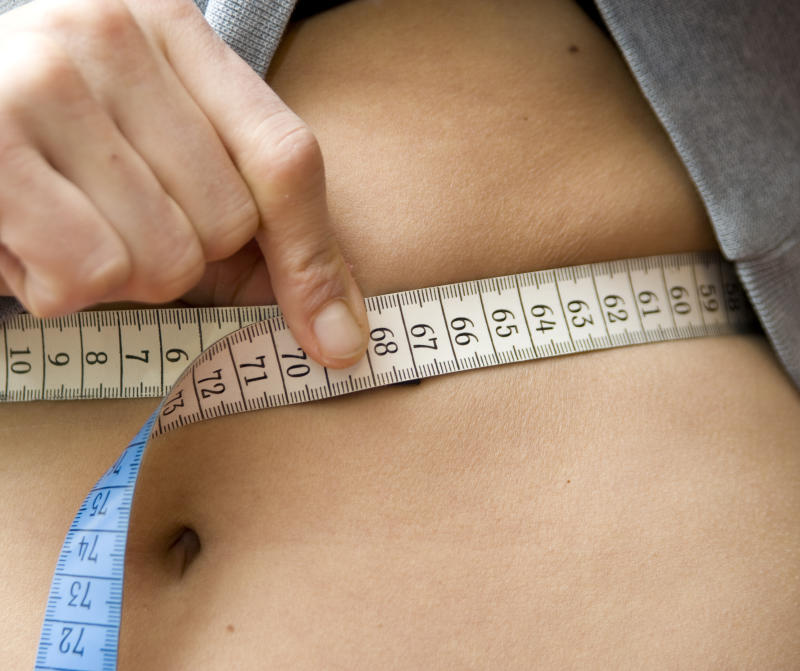 New research has revealed waist size could give a better indication of overall health than BMI [Photo: Getty]