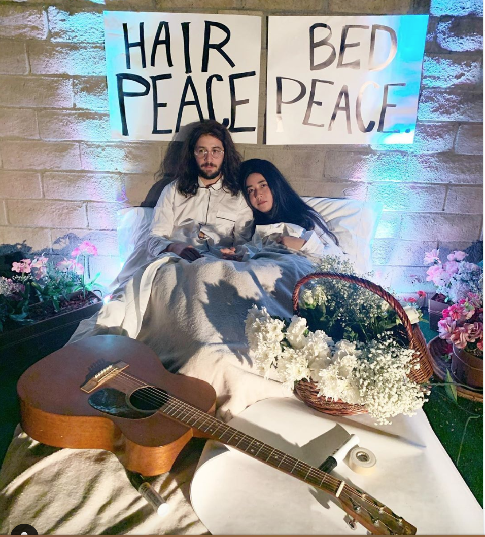 <p>Michael Angarano and Maya Erskine went for not just the matching celebrity Halloween costumes but the entire setup. In 2019, the two chose to recreate looks from Beatle John Legend and his wife, Yoko Ohno.</p>