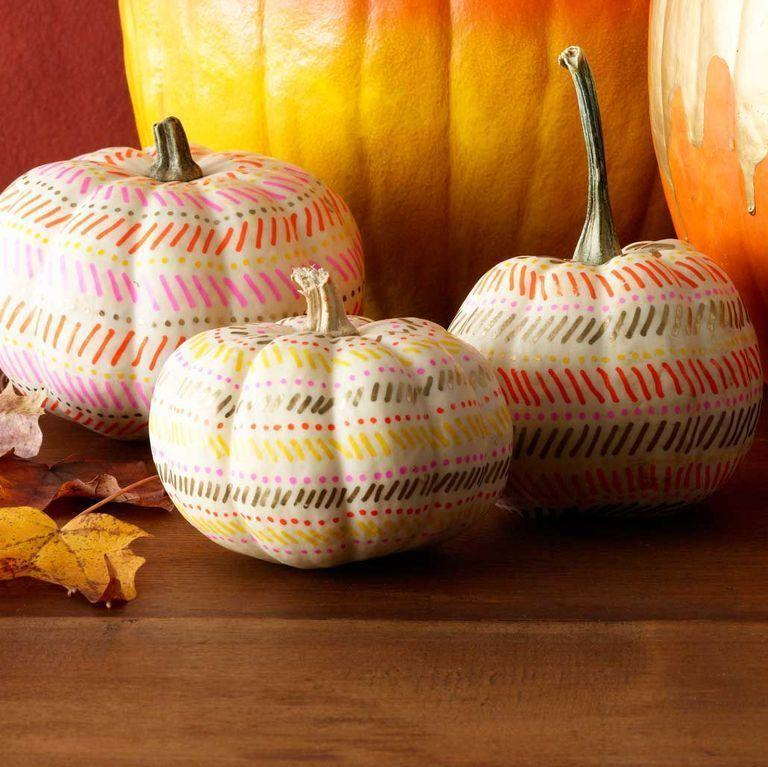 """<p>Have an artsy side? Let it out by using paint pens to draw a fun design onto white pumpkins. </p><p><a class=""""link rapid-noclick-resp"""" href=""""https://www.amazon.com/Painting-Ceramic-Acrylic-Markers-Extra-fine/dp/B07485T22B?tag=syn-yahoo-20&ascsubtag=%5Bartid%7C10070.g.331%5Bsrc%7Cyahoo-us"""" rel=""""nofollow noopener"""" target=""""_blank"""" data-ylk=""""slk:SHOP PAINT PENS"""">SHOP PAINT PENS</a> </p>"""
