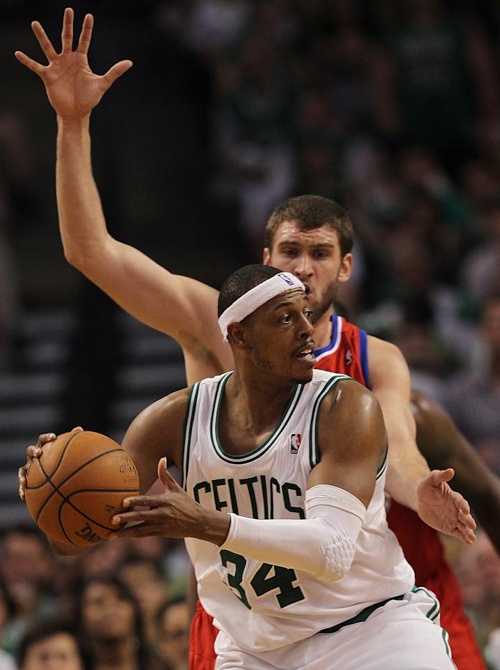 BOSTON, MA - MAY 26:  Paul Pierce #34 of the Boston Celtics is defended by Spencer Hawes #00 of the Philadelphia 76ers during Game Seven of the Eastern Conference Semifinals during the 2012 NBA Playoffs on May 26, 2012 at TD Garden in Boston, Massachusetts. NOTE TO USER: User expressly acknowledges and agrees that, by downloading and or using this photograph, User is consenting to the terms and conditions of the Getty Images License Agreement. (Photo by Jim Rogash/Getty Images)