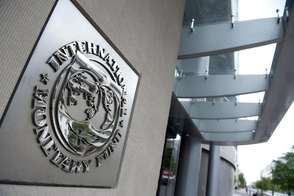 The IMF executive board completed the combined fifth, sixth and seventh reviews of Cyprus's program and approved the disbursement of 278.4 million euros (AFP Photo/Saul Loeb)