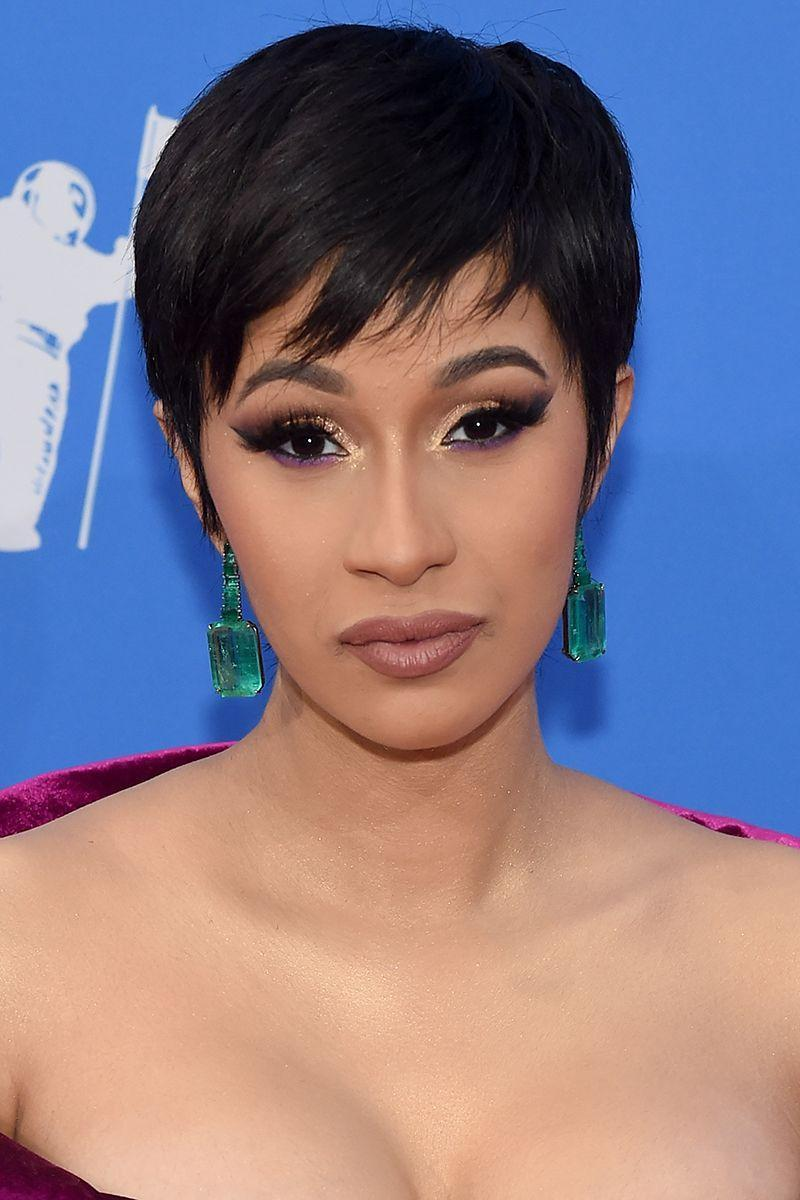 <p>While we love all of Cardi B's colored wigs, we hold a very special place in our heart for this layered pixie cut with bangs. </p>
