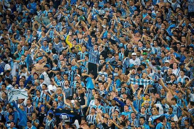 Brazil's sports tribunal throws top flight club Gremio out of the national Cup after fans racially insulted a visiting black goalkeeper (AFP Photo/Vinicius Costa)