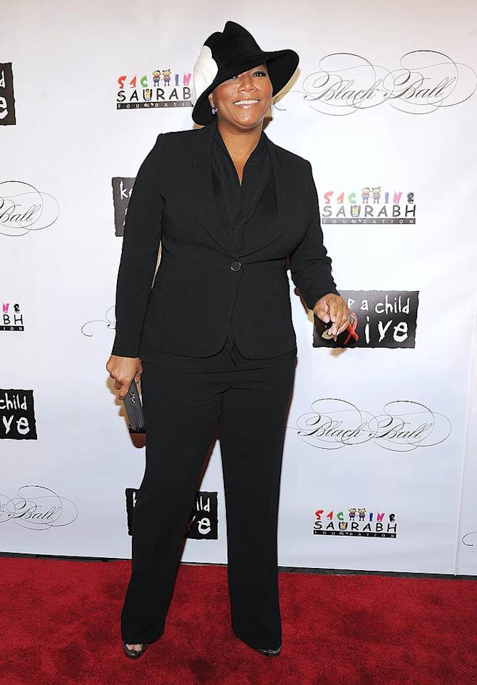 Queen Latifah, a former emcee of the Black Ball, took a cue from the guys and strutted her stuff in a suit, which she topped off with a snazzy hat. (11/3/2011)