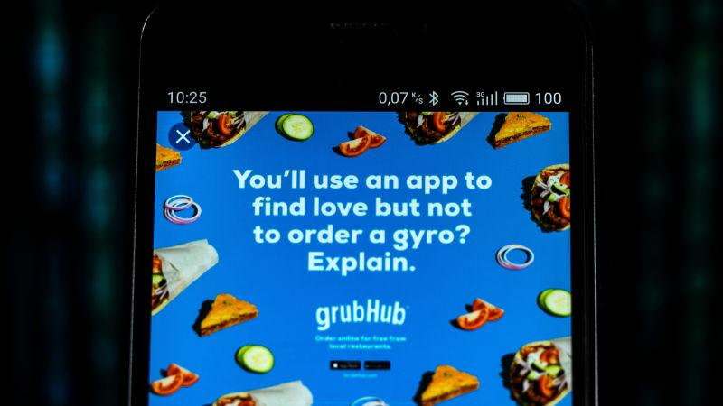 "A Grubhub ad on a phone screen reading, ""You'll use an app to find love but not to order a gyro? Explain."""