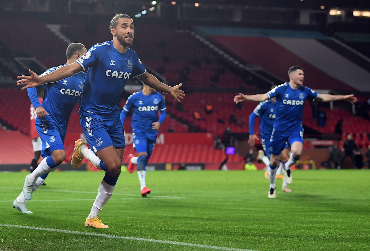 Everton's English striker Dominic Calvert-Lewin celebrates scoring his team's third goal during the English Premier League football match between Manchester United and Everton at Old Trafford in Manchester, north west England, on February 6, 2021. (Photo by Michael Regan / POOL / AFP) / RESTRICTED TO EDITORIAL USE. No use with unauthorized audio, video, data, fixture lists, club/league logos or 'live' services. Online in-match use limited to 120 images. An additional 40 images may be used in extra time. No video emulation. Social media in-match use limited to 120 images. An additional 40 images may be used in extra time. No use in betting publications, games or single club/league/player publications. /  (Photo by MICHAEL REGAN/POOL/AFP via Getty Images)