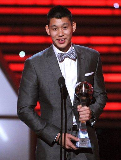 NBA player Jeremy Lin accepts the Best Breakthrough Athlete award onstage during the ESPY Awards on July 11. The New York Knicks confirmed late Tuesday they wouldn't match Houston's three-year, $25 million offer for Lin