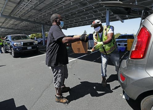 """<span class=""""caption"""">A community drive-thru distribution centre in Vallejo, California in June 2020. </span> <span class=""""attribution""""><span class=""""source"""">John G. Mabanglo/EPA</span></span>"""