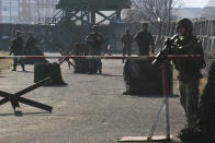 Members of Kosovo's Security Forces man a checkpoint during an exercise in southeastern town of Gjilan, Kosovo on Thursday, Dec. 13, 2018, a day before the parliament votes to transform them into a regular army. Kosovo lawmakers are set to transform the Kosovo Security Force into a regular army, a move that significantly heightened tension with neighboring Serbia which even left open a possibility of an armed intervention in its former province. (AP Photo/Visar Kryeziu)