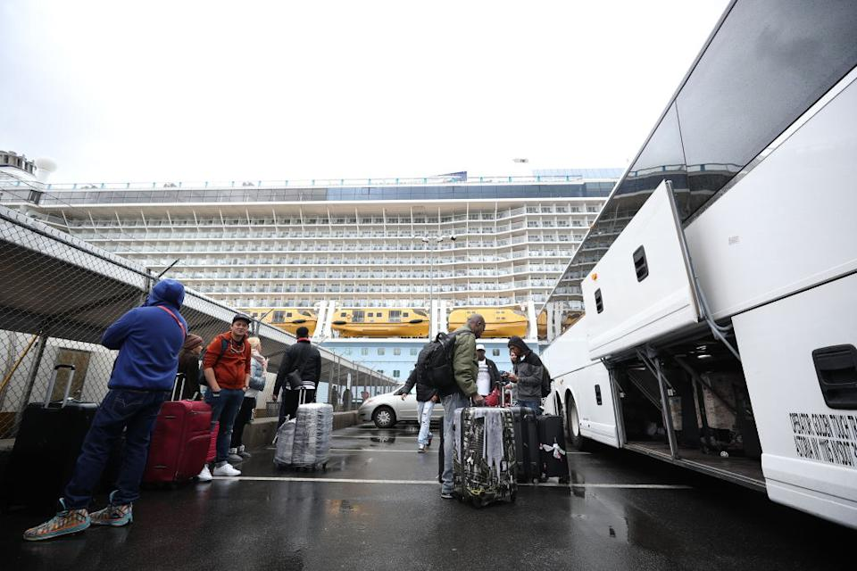Passengers leave the vessel as four were taken away for further testing. Source: Getty
