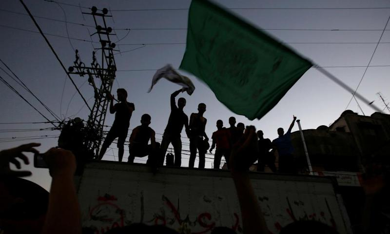 A Palestinian person waves a Hamas flag in Gaza City. The group's new charter could be the last chance 'to put Gaza on a sensible path', says a diplomatic source.