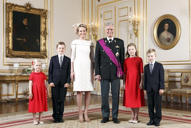 In this photo released by the Belgian Prime Ministers Office, Belgium's royal family poses for a photo at the royal palace in Brussels on Sunday, July 21, 2013. From left, Princess Eleonore,Prince Gabriel, Queen Mathilde, King Philippe, Princess Elisabeth and Prince Emmanuel. (AP Photo/Belgium Prime Ministers Office, HO)