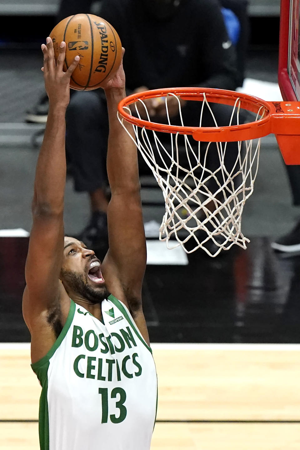 Boston Celtics center Tristan Thompson dunks against the Chicago Bulls during the first half of an NBA basketball game in Chicago, Friday, May 7, 2021. (AP Photo/Nam Y. Huh)