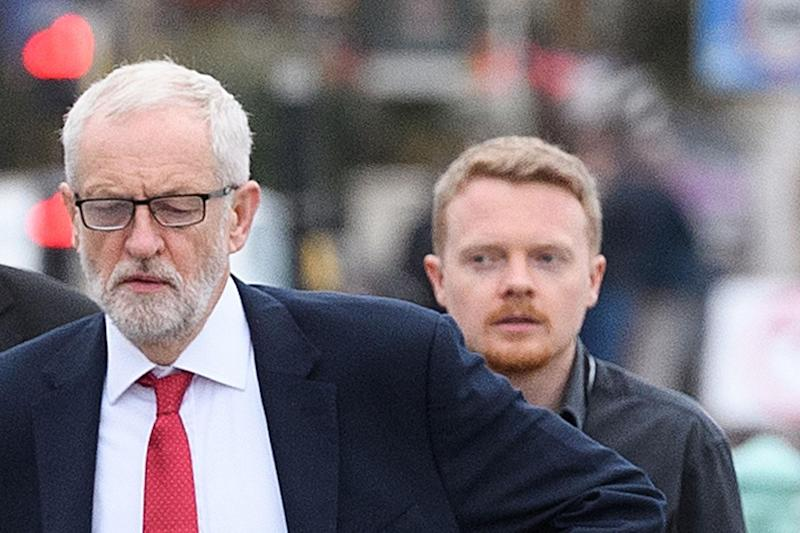 Jeremy Corbyn with Labour activist Andrew Fisher (Photo by Leon Neal/Getty Images)