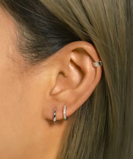 "<h2>Amy O Tiny Huggie Hoop Earrings</h2> <br>""I never thought about the size of my earlobes, and how they might be small on the spectrum of others' lobes, until last year when I wanted a pair of silver huggie earrings. The first pair of teeny hoops meant to fit snuggly around my earlobes did not hug at all — in fact, there was barely a friendly embrace. Recently, I found the Goldilocks of huggies at Amy O. <a href=""https://amyojewelry.com/collections/earrings-huggies/products/tiny-huggie-hoop-earrings-gold"" rel=""nofollow noopener"" target=""_blank"" data-ylk=""slk:These little silver buddies"" class=""link rapid-noclick-resp"">These little silver buddies</a> come in 6mm and 7mm — or, if your earlobes are a bit larger than mine, there are also styles <a href=""https://amyojewelry.com/collections/earrings-huggies/products/huggie-hoop-earrings-14k-gold"" rel=""nofollow noopener"" target=""_blank"" data-ylk=""slk:like this"" class=""link rapid-noclick-resp"">like this</a> pair that come in 6.5mm and 8mm. I also like that the company is founded and run by women right here in NYC. Not a need, but an affordable, happy pick-me-up buy."" <em>– Marissa Rosenblum, Senior Shopping Director</em><br><br><em>Shop <strong><a href=""https://amyojewelry.com/"" rel=""nofollow noopener"" target=""_blank"" data-ylk=""slk:Amy O"" class=""link rapid-noclick-resp"">Amy O</a></strong></em><br><br><strong>Amy O Jewelry</strong> Tiny Huggie Hoop Earrings, $, available at <a href=""https://go.skimresources.com/?id=30283X879131&url=https%3A%2F%2Famyojewelry.com%2Fcollections%2Fearrings-huggies%2Fproducts%2Ftiny-huggie-hoop-earrings-silver"" rel=""nofollow noopener"" target=""_blank"" data-ylk=""slk:Amy O"" class=""link rapid-noclick-resp"">Amy O</a><br><br><br>"