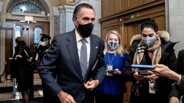 PHOTO: Sen. Mitt Romney speaks to reporters as he arrives on the fifth day of the second impeachment trial of former President Donald Trump, Feb. 13, 2021, at the Capitol in Washington, D.C. (Stefani Reynolds/Pool via AP)