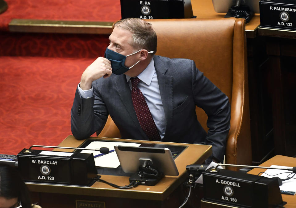 Assembly Minority Leader William A. Barclay, R- Fulton, watches the tote board for results as members explain their votes while debating budget bills during a Legislative session in the Assembly chamber at the state Capitol, Wednesday, April 7, 2021, in Albany, N.Y. (AP Photo/Hans Pennink)