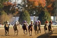 Florent Geroux (10) rides Monomoy Girl to win the Breeders' Cup Distaff horse race at Keeneland Race Course, in Lexington, Ky., Saturday, Nov. 7, 2020. (AP Photo/Mark Humphrey)