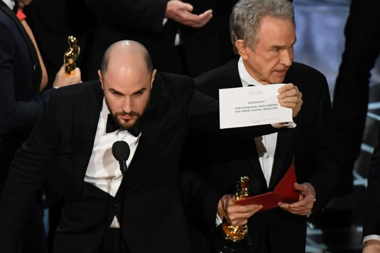 """La La Land"" producer Jordan Horowitz holds up the card reading Best Film 'Moonlight"" next to presenter Warren Beatty, who was initially handed the wrong envelope in 2017"