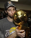 FILE - Los Angeles Lakers' Pau Gasol, from Spain, kisses the Larry O'Brian trophy after the Lakers won the NBA basketball championship in Orlando, Fla., in this Sunday, June 14, 2009, file photo. Pau Gasol announced his retirement from basketball on Tuesday, Oct. 5, 2021, ending a career that lasted more than two decades and earned him two NBA titles and a world championship gold with Spain's national team. (AP Photo/David J. Phillip, File)