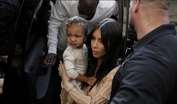 North West and her mom via AFP