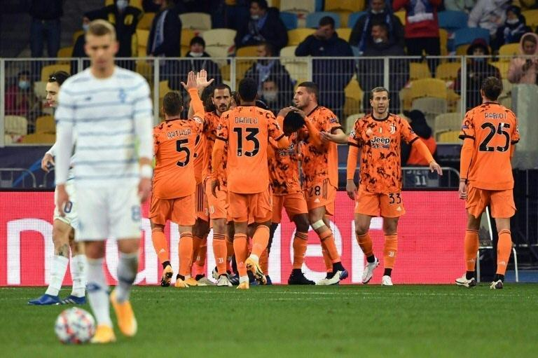 Juventus' players celebrate after getting their Champions League campaign off to a winning start in Kiev