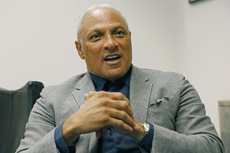 Mississippi Democrat Mike Espy explains, Tuesday, Nov. 12, 2019, at his Jackson, Miss., office, how he is using data to help him pursue votes in a run for the U.S. Senate against Republican incumbent Cindy Hyde-Smith, setting up a 2020 rematch of their 2018 special election to fill the last two years of retired Republican Sen. Thad Cochran's six-year term. Espy announced Tuesday morning that he's running again for U.S. Senate in Mississippi. (AP Photo/Rogelio V. Solis)