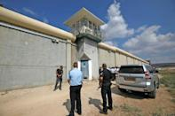 Israeli security personnel gather outside the Gilboa Prison in northern Israel (AFP/Jalaa MAREY)