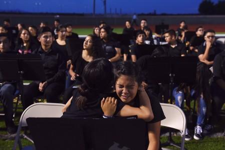 People pay their respects two days after a mass shooting in El Paso