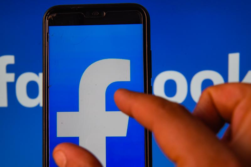 In this photo illustration a Facebook logo is seen displayed on a smartphone. (Photo Illustration by Omar Marques/SOPA Images/LightRocket via Getty Images)