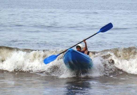 Kayaking through violent waves at a beach in Goa.