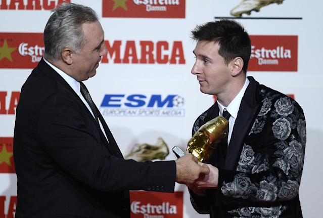 Former soccer player Hristo Stoichkov from Bulgaria, left, gives the Golden Boot award to Barcelona's Lionel Messi from Argentina for scoring the most goals in Europe's domestic leagues last season in Barcelona, Spain, Wednesday, Nov. 20, 2013. (AP Photo/Manu Fernandez)