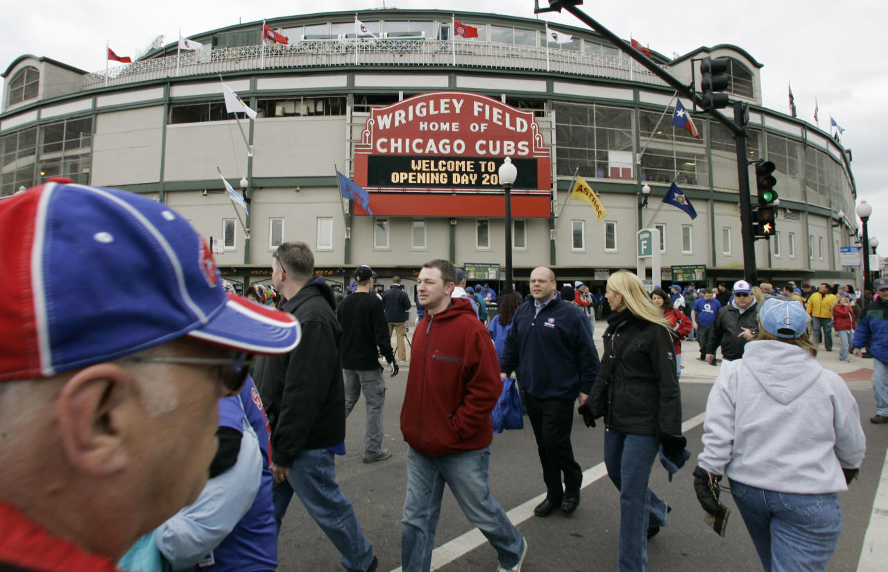 FILE - In this April 7, 2007 file photo, Chicago Cubs fans gather on opening day outside Wrigley Field in Chicago. Chicago's Wrigley Field, New Orleans' Saenger Theatre and a historic Los Angeles' shipbuilding center have joined a list of sites being saved thanks to the efforts of historic preservationists in 2013. (AP Photo/M. Spencer Green, File)