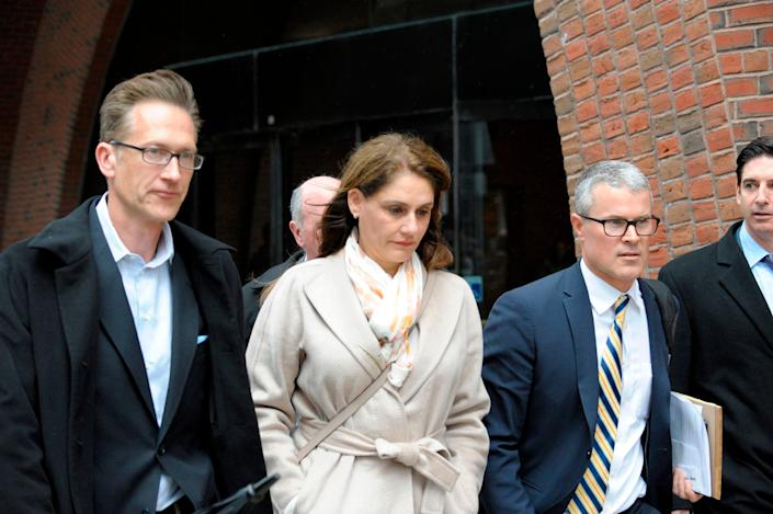 Michelle Janavs, former executive of a food manufacturer, makes her way out of the courthouse after giving her plea in front of a judge for charges in the college admissions scandal at the John Joseph Moakley United States Courthouse in Boston on March 29, 2019.