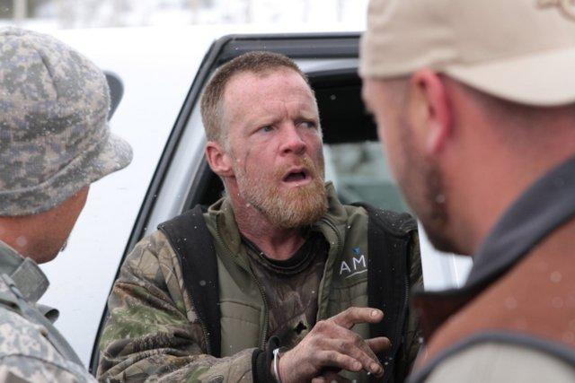 This image provided by the Emery County Sheriff's Office shows detectives placing fugitive Troy James Knapp into custody Tuesday April 2, 2013, in mountains outside of Ferron in central Utah. Authorities captured the elusive survivalist on Tuesday who is suspected of burglarizing Utah cabins and leaving some covered with threats and bullet holes — ending a saga that began six years ago. (AP Photo/Emery County Sheriff's Office)
