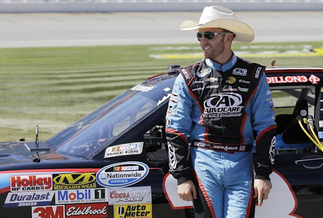 Austin Dillon leans on his car before qualifying for the NASCAR Nationwide series auto race at Chicagoland Speedway in Joliet, Ill., Saturday, Sept. 14, 2013. (AP Photo/Nam Y. Huh)