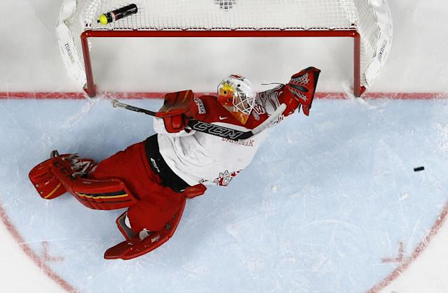 <p>George Sorensen of Denmark defends the goal during a 2017 IIHF World Championship group A game against Sweden in Cologne, Germany, May 14, 2017. (Photo: Wolfgang Rattay/Reuters) </p>