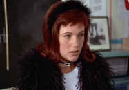 <p>This look is still on our to-do list. The marabou feather headband perfectly matches the marabou feather shrug and we mean...don't even get us started on that buckle choker. </p>